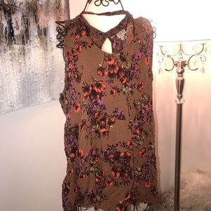 Trendy brown sleeveless floral top